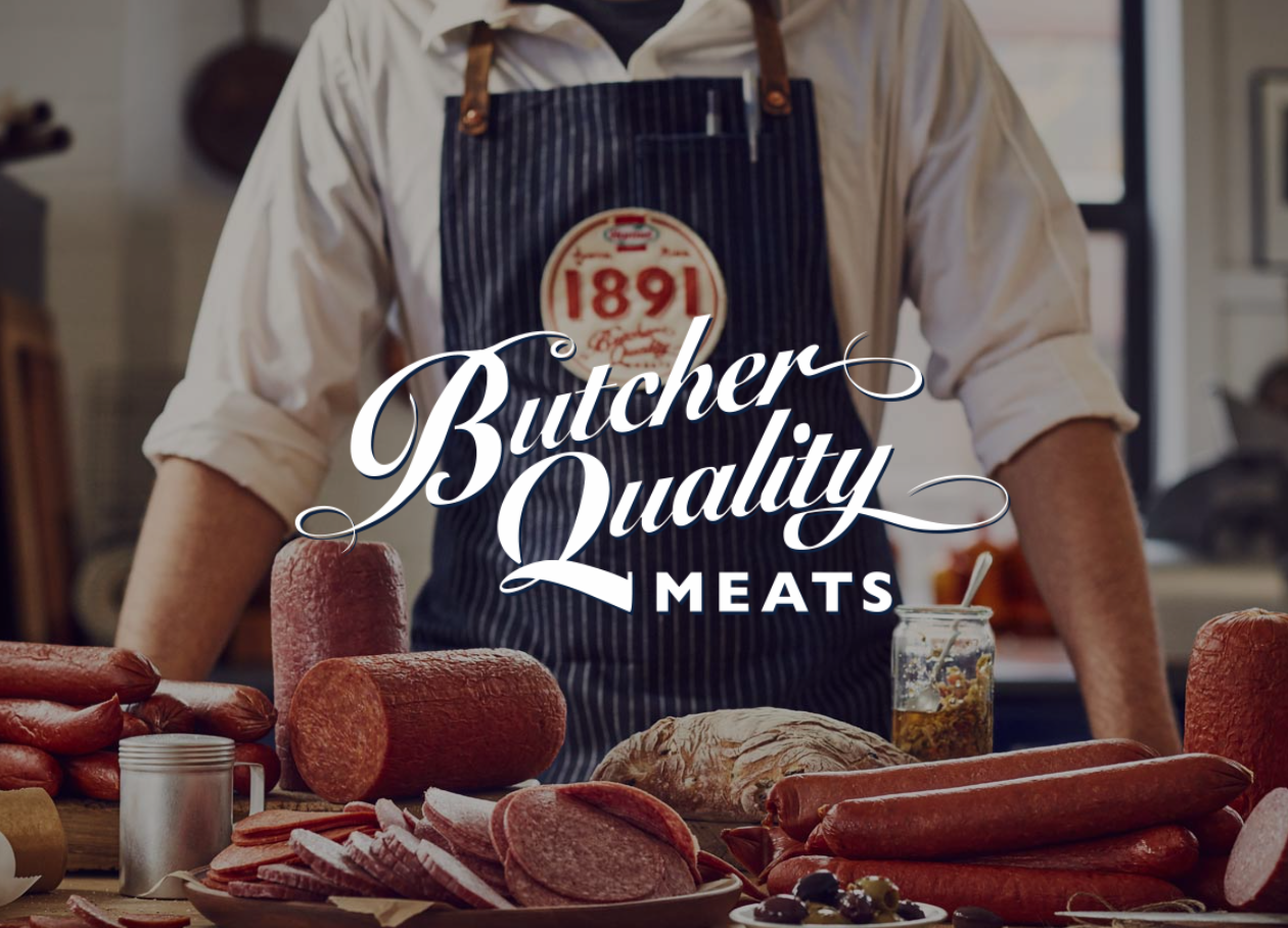 Butcher Quality Meats 1891 chef looking at cured meats