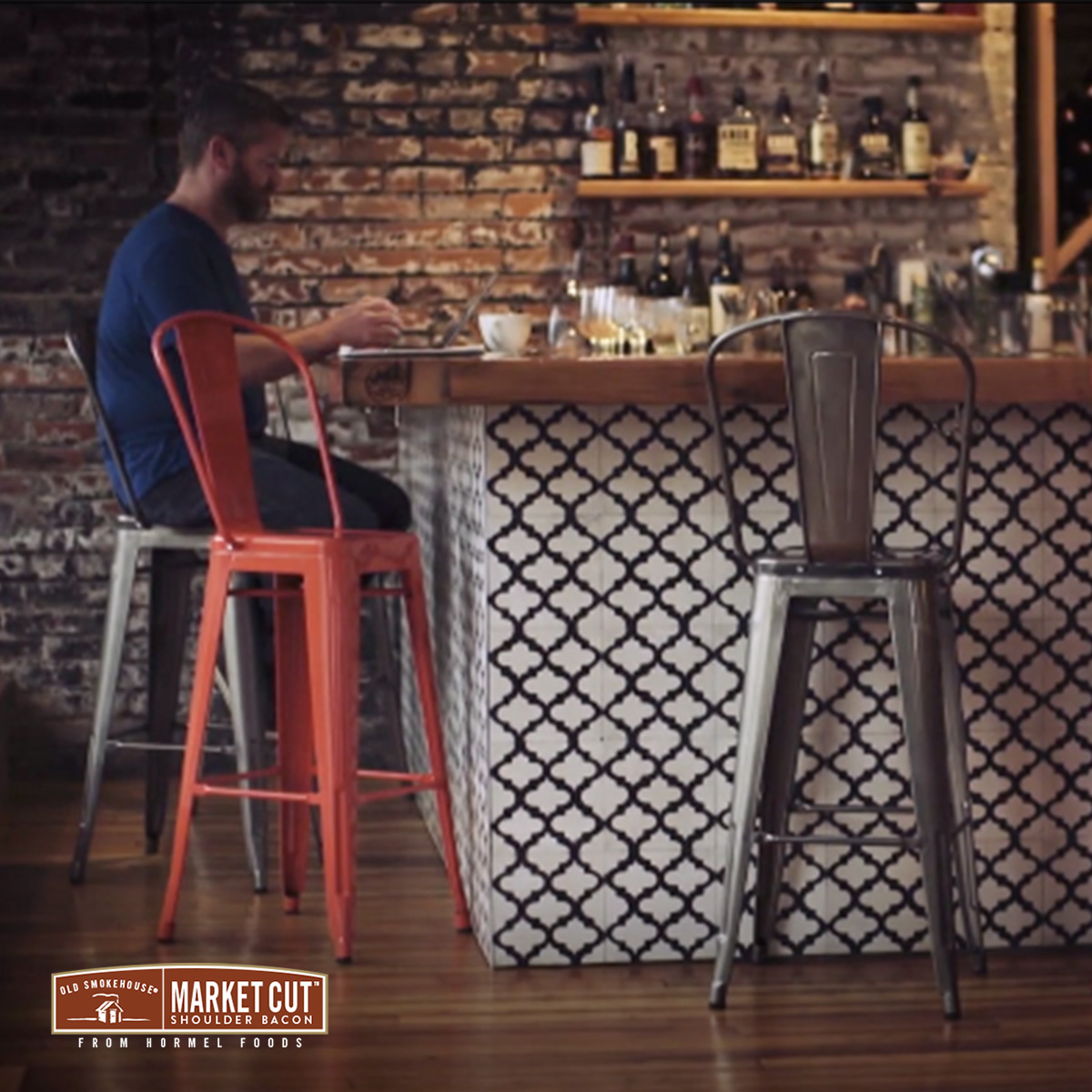 Market Cut Bacon man sitting at bar